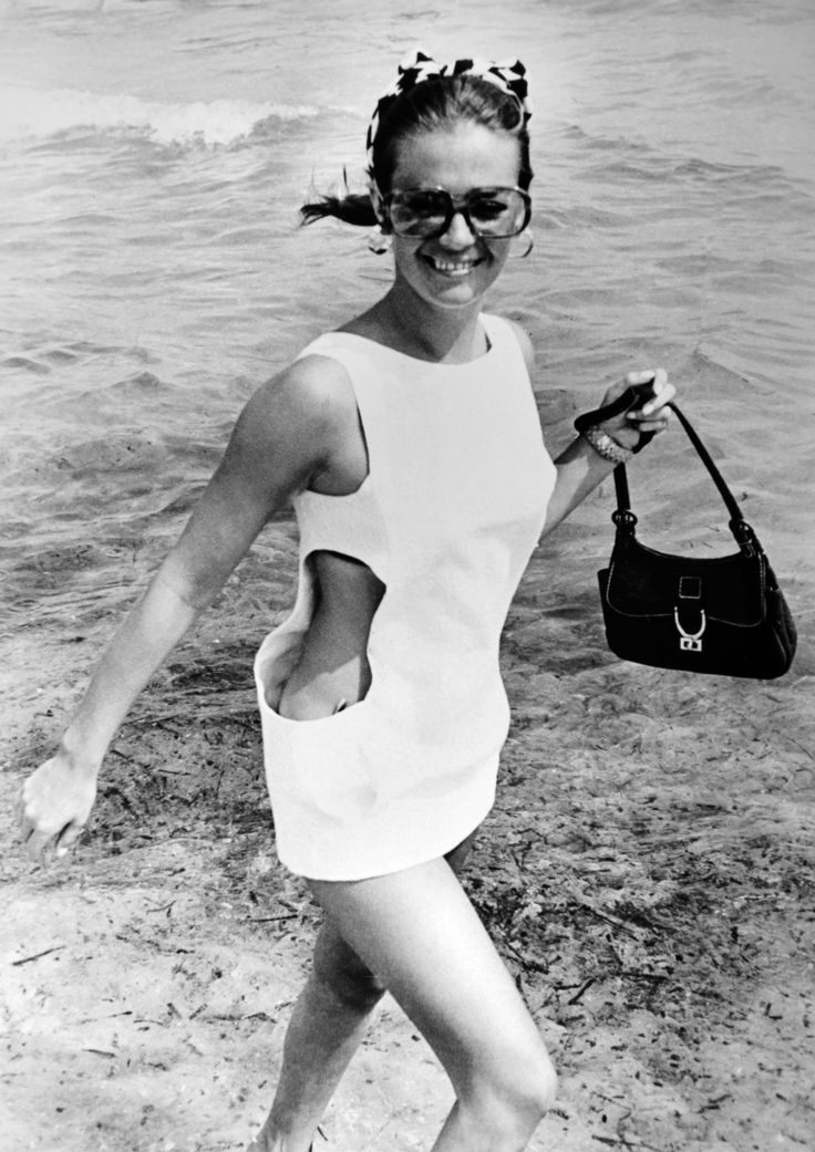 Natalie Wood frolics on the beach in a mod, bug-eyed pair, 1968.