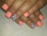nails.peach acrylic with bedazzled
