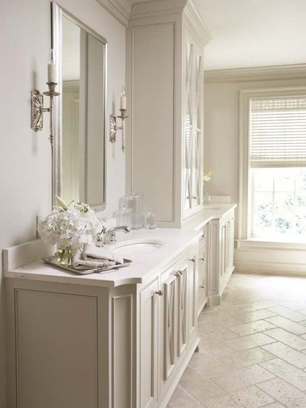 The Best Cream Bathrooms -Herringbone Ivory Travertine floors and a Crema Marfil countertop are often paired together.