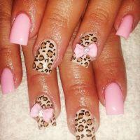 Bow and cheetah nail design