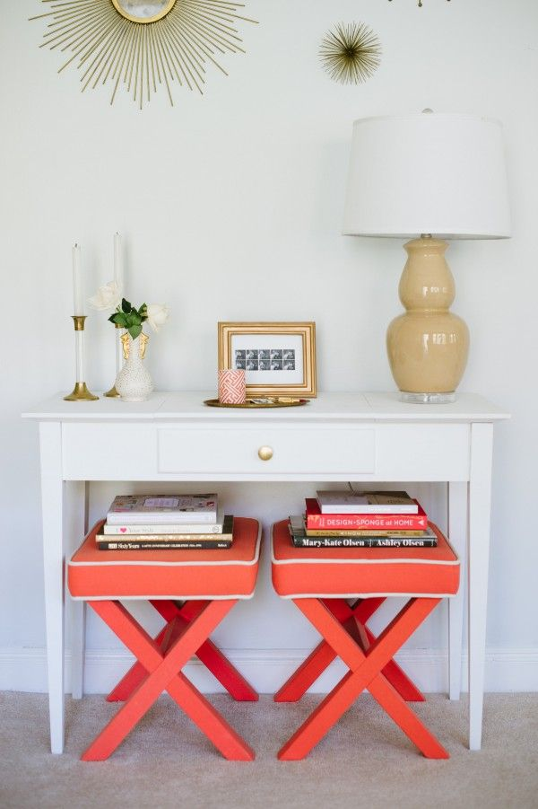 Colorful benches under white console table.