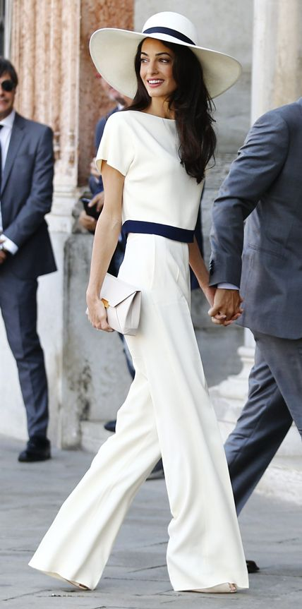 Amal Alamuddin (with now-husband George Clooney) wrapped up their wedding festivities with a civil ceremony at Venice's Municipal Building in a chic ivory-and-navy top (that matched her wide-brimmed hat) and ivory pants with a neutral clutch. #InStyle