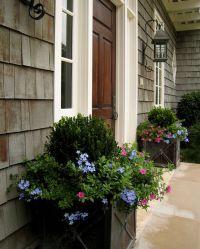 front porch planters under coach-lights.