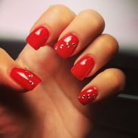 Red nails with diamonds