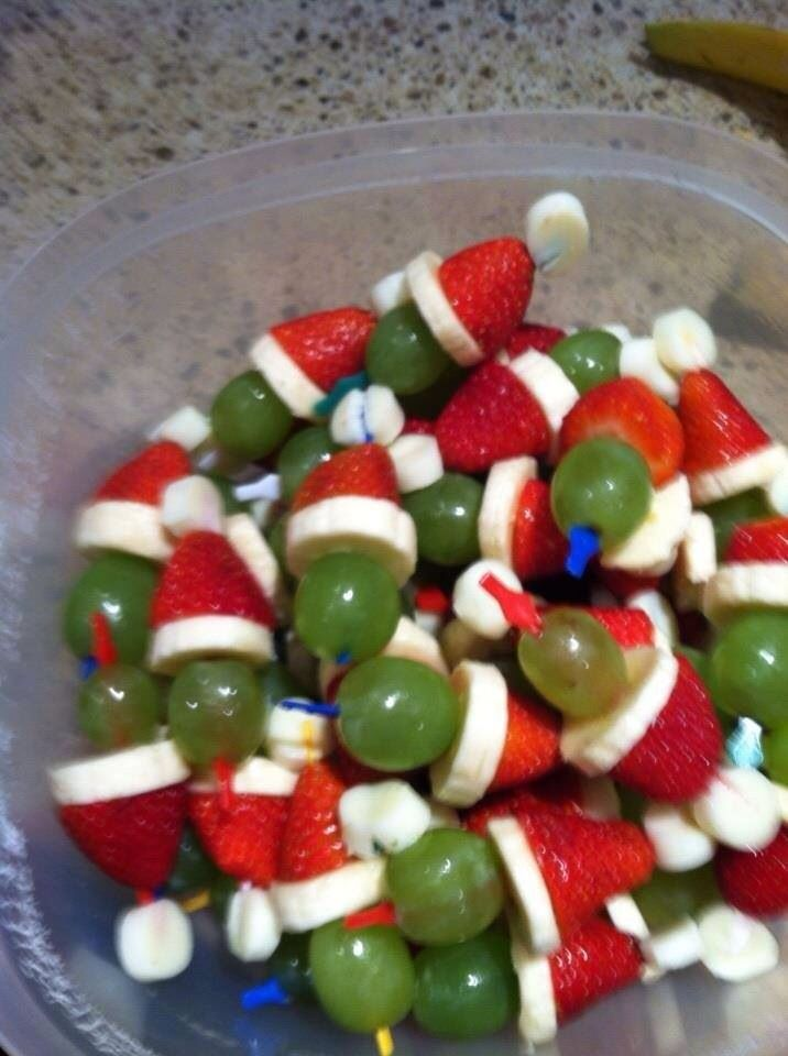Grinch kabobs- layer: mini marshmallows, strawberry, banana slice and green grape on a tooth pick! Perfect Christmas appetizer for a party or family gathering