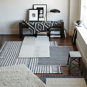 great mixture of textural grays and neutrals. especially in love with the rajasthan-striped dhurrie.