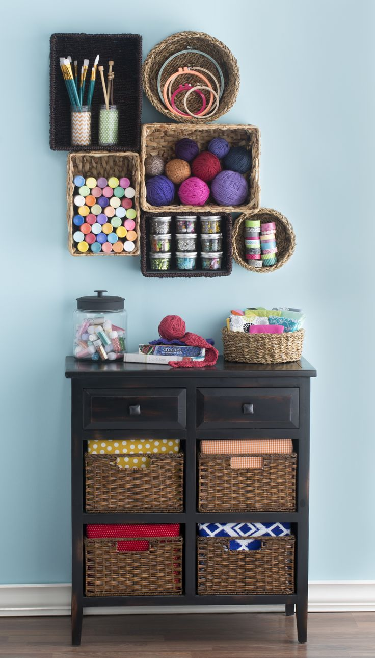 Show off your creative side! Hang baskets on the wall to display your craft supplies as functional art.