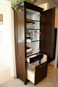 bathroom cabinet with laundry bin