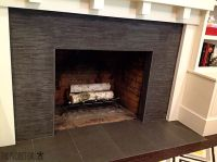 Fireplace surround - black tile. | Fireplace Ideas | Pinterest