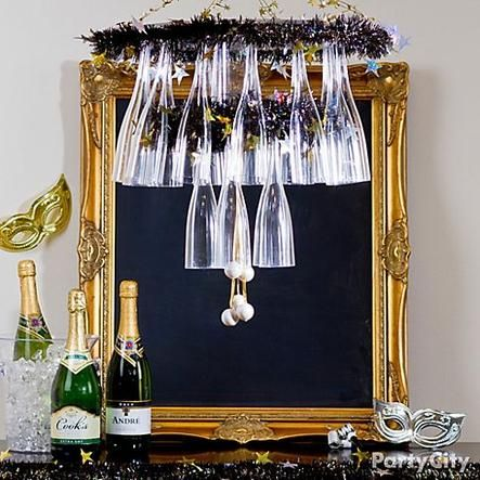 Get oohs and aahs from your party peeps with a DIY champagne flute chandelier! Click the pic to see how and get more inspired New Year's Eve party ideas.