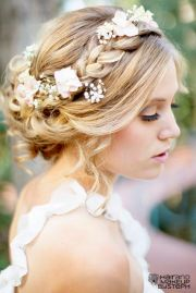 braided updo with flowers beach
