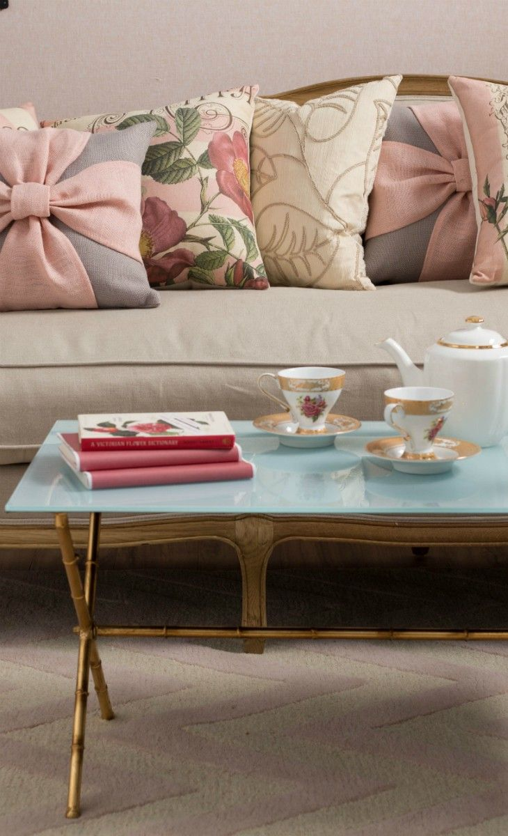 See how wrong my life is? I love this.   Rose and Gold Pillows-  Love that Coffee table!