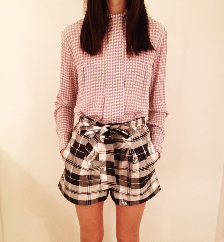 Ashleigh at our Soho store wears Valiant Mirror Check Short and Valiant Tie Blouse