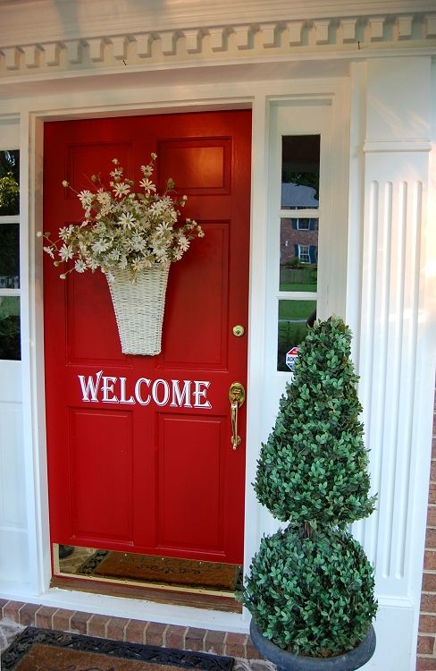 Pretty, inviting front door. Side Note:  houses with bright doors sell quicker. It's a fact.