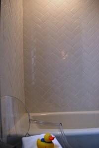 Subway tiles in herringbone pattern | TILE - Showers ...