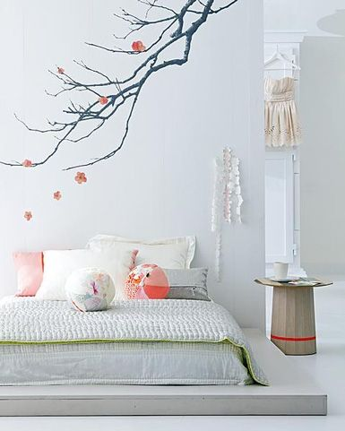 Not really a fan of low beds, but this room is gorgeous. Love the branch!