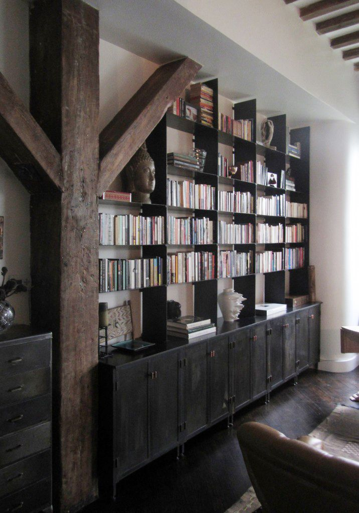 built ins with closed cabinets on the bottom and shelves above