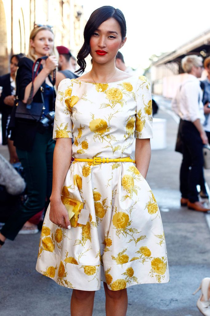 Nicole Warne of Gary Pepper Girl in a floral dress and red lip