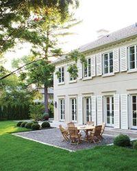 White shutters, off-white house.