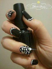 black and rhinestone nail art