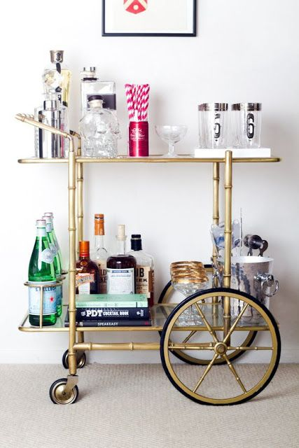 Bar Carts...I feel like I may need one with big wheels so I can take it from the dining room, to the porch, to the tub...not just to sit in the corner and look pretty.
