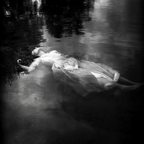 "A black & white reenactment of ""Ophelia"" inspired by Shakespeare's Hamlet."