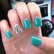 teal nails with nail design