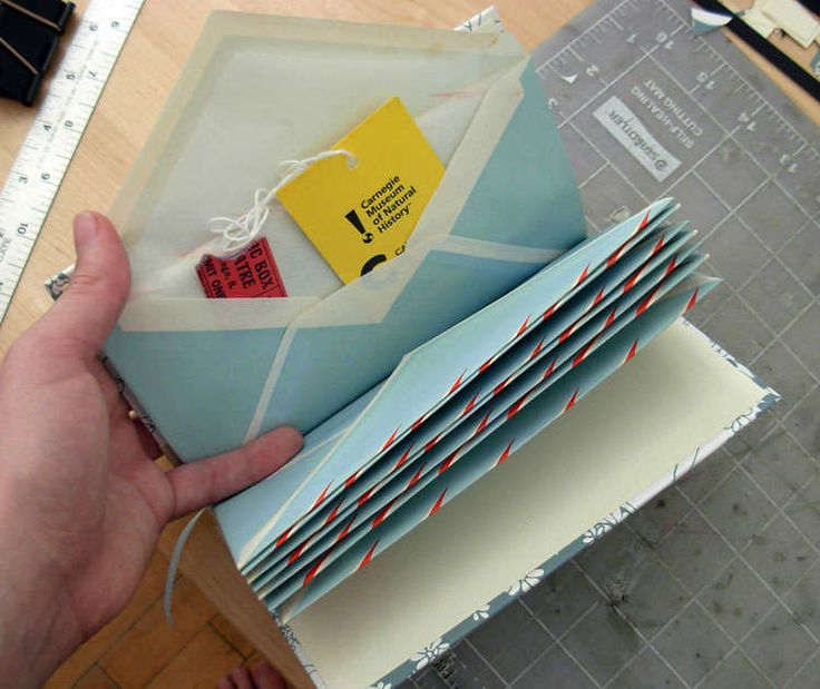 How to make an envelope book - so neat! Could put love notes from over the years then give as a gift.... Cute!