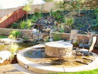 Fire pit by water feature | Back yard | Pinterest