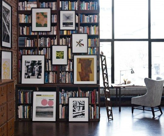 artwork and bookshelf. oh and the window isn't bad either.