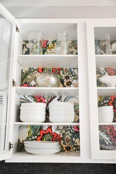 Surprise wallpaper behind the cabinet doors! WANT. -Momo