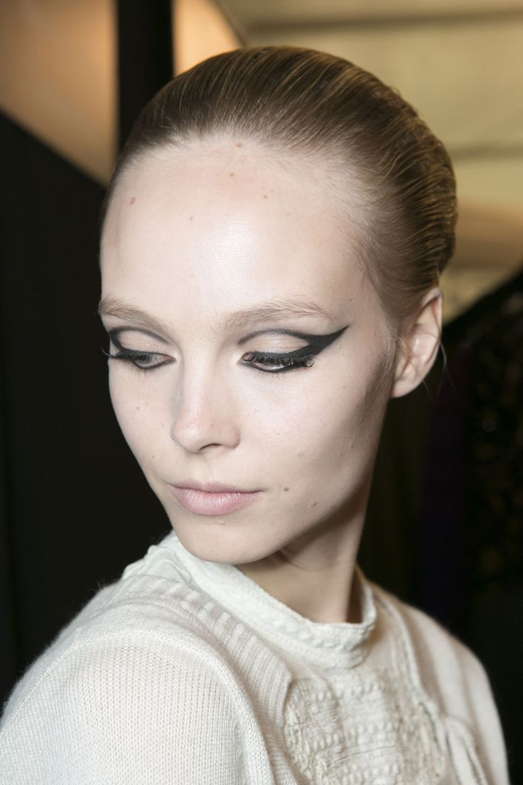 Cat-Eye Makeup: The mod liner at Chado Ralph Rucci featured a winged shape that outlined the contours of the eyes.