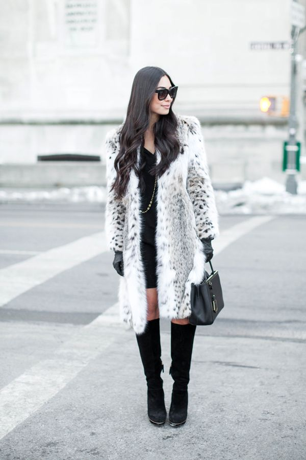 how to wear white in the winter. I wouldn't do real fur, but a nice white/cream coat over black dress and black boots with black gloves-perfect.