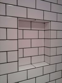Subway tiles with black grout | 1920s shower room | Pinterest