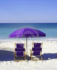 Purple beach chairs and umbrella