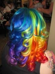 beautiful curly rainbow dyed hair