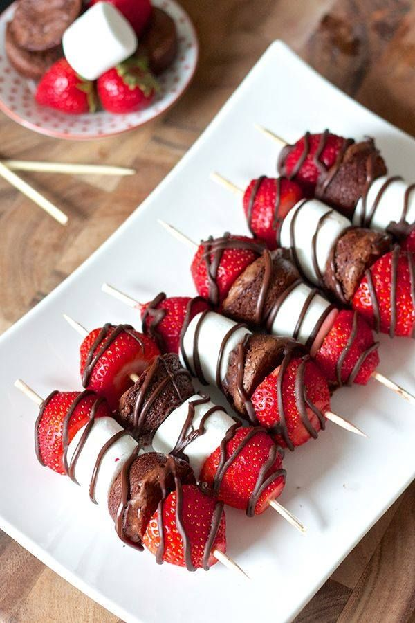 Fresh Stawberries, marshmallows, a soft toffee filled chocolate.  Put them together and drizzle with melted chocolate and you have a party on a stick!