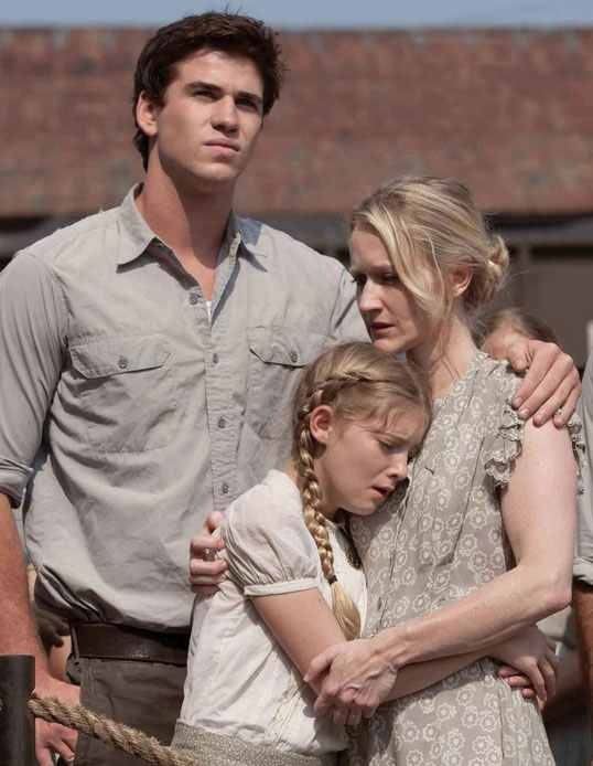 Gale, Prim, and Mrs. Everdeen after Katniss volunteers. I may be team peeta and may not like gale that much but he still cares about katniss's family, and I love that about him!