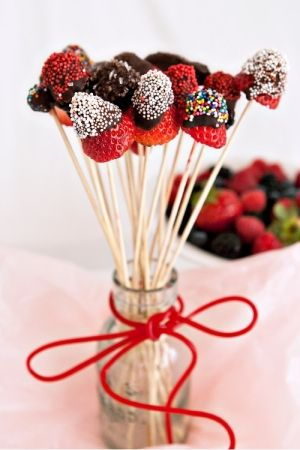 Delightfully fun little chocolate and sprinkle covered berry bites on sticks. #fruit #chocolate #strawberries #food #sprinkles #party