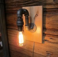 Black Pipe Wall Sconce Light on maple wood mounting