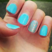 light blue and gold chevron nails
