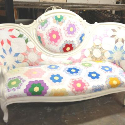 Sweet little settee recovered in a couple of old quilts.