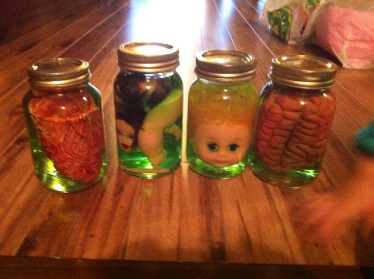 Dolls in a jar. Spooky Halloween decoration.