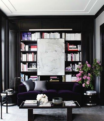 black walls + purple velvet sofa