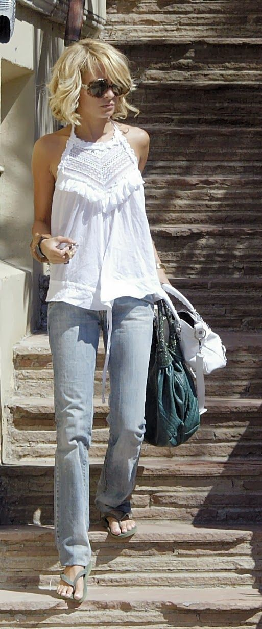 Lovely spring/summer fashion. White lace/crochet top plus vintage wash denim jeans.