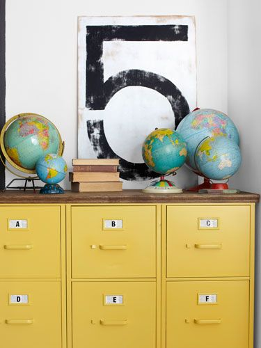 Spray-painted yellow and topped with plywood, three Goodwill filing cabinets