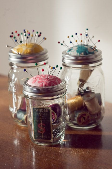 Upcycled mason jar pincushions using fabric scrap, batting, thin cardboard, hot glue gun and glue, scissors. #Glass #Craft and #Ideas