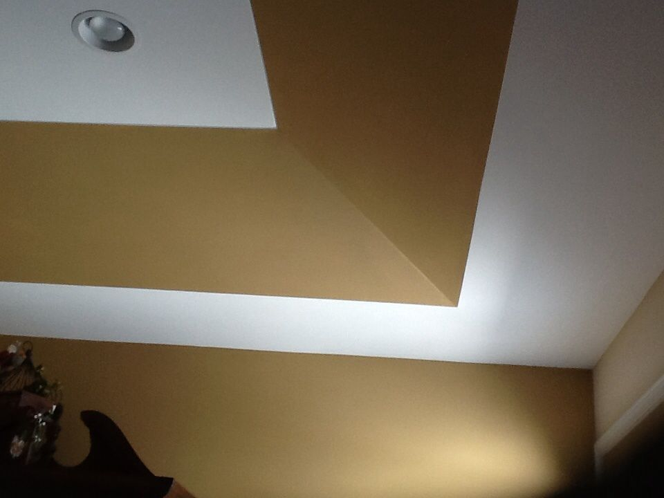 Painting a tray ceiling to add interest.