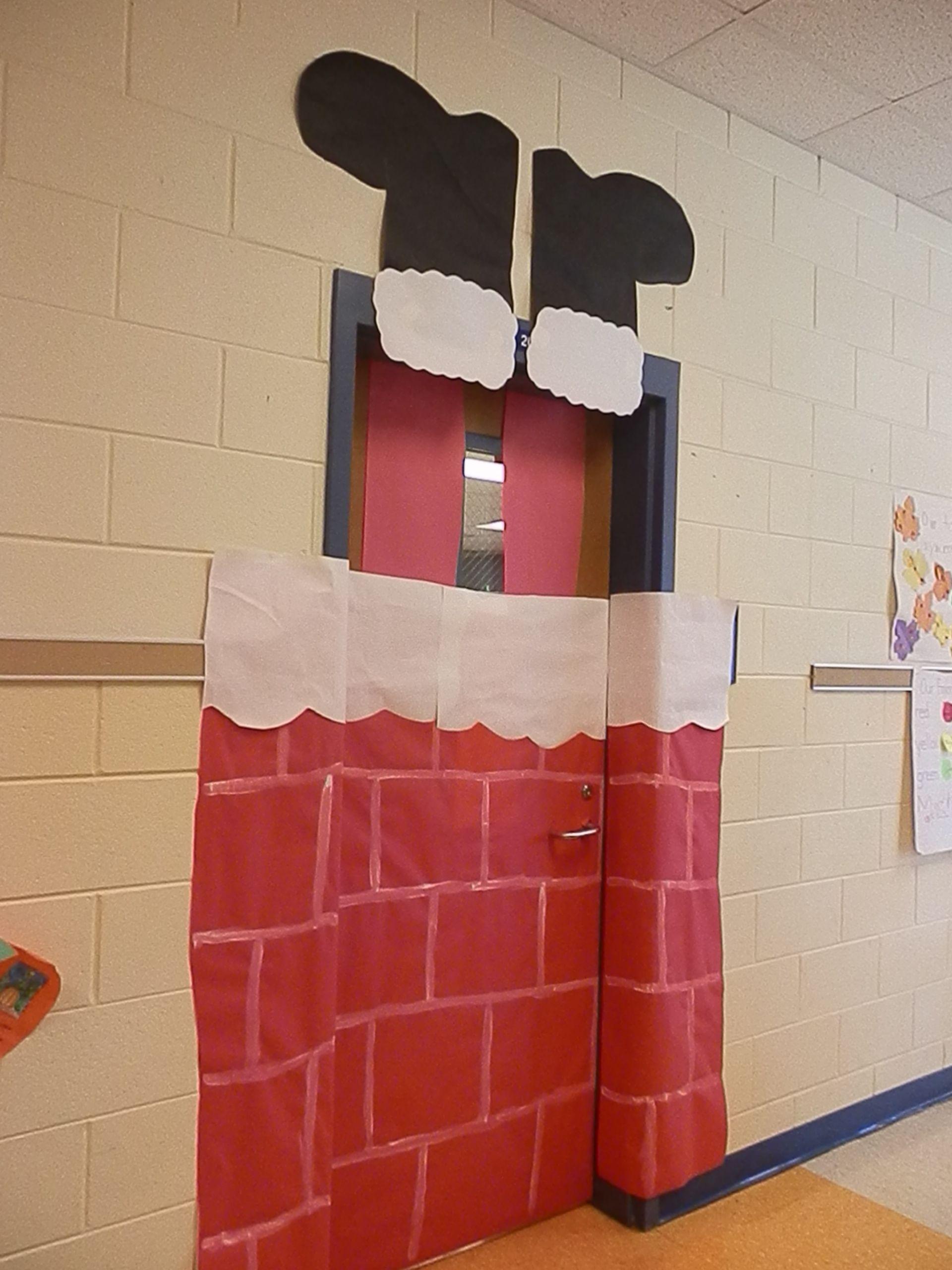 Santa stuck in the chimney door decoration