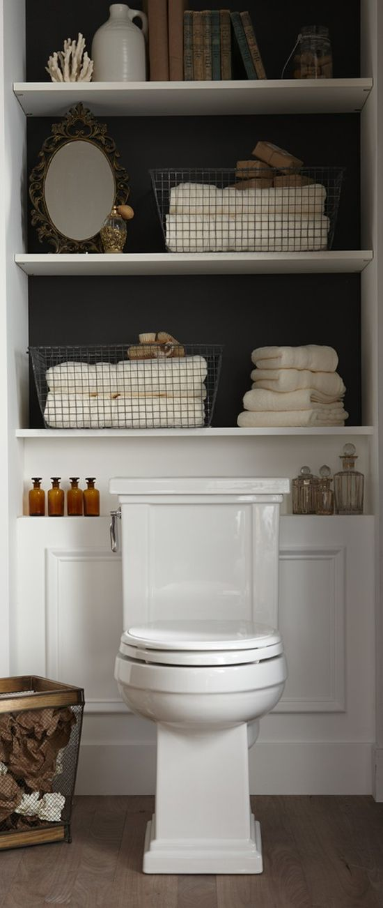 Shelving Above Toilet - perfect use for normally dead space.  Like the bold wall color behind. So cute for a half bath.